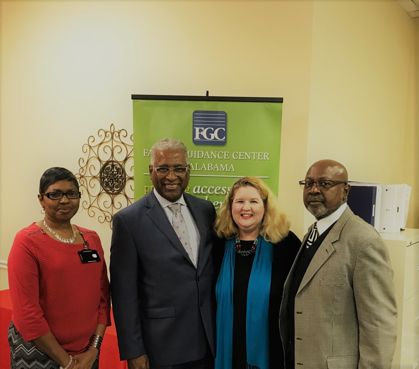 Pictured (L to R): Ms. Sybil L. Scarbrough, Mayor William A. Bell, Sr., Ms. Regina G. Allison, and Mr. Lorenza Thomas